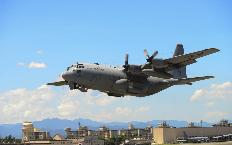 A C-130 Hercules takes off during a training exercise at Yokota Air Base, Japan, on Tuesday, July 14, 2015. Ten C-130s participated in the exercise which tested the 36th Airlift Squadron?s ability to perform large formation flights.
