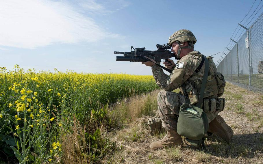 A 91st Security Forces Group member guards the fence line of a launch facility during an exercise near Donnybrook, N.D., on Monday, June 29, 2015. Airmen from 219th Security Forces Squadron and 791st Missile Security Forces Squadron worked together to pacify personnel dressed as simulated aggressors and recapture a launch facility.