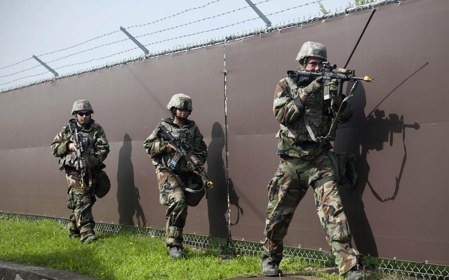 Airmen from the 8th Security Forces Squadron conduct perimeter security following a simulated ground attack during Exercise Beverly Midnight 15-4 at Kunsan Air Base, Republic of Korea, on Thursday, July 16, 2015. Airmen reacted, survived and operated in a simulated combat zone.