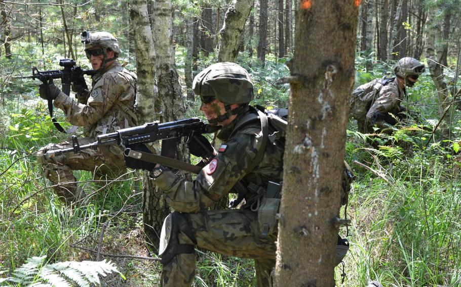 U.S. Soldiers with the 2nd Cavalry Regiment and Polish soldiers from the 6th Airborne Brigade pull security before navigating to an observation point July 17, 2015, near Nowa Deba, Poland. The exercise was part of Operation Atlantic Resolve, focused on joint training and security cooperation.