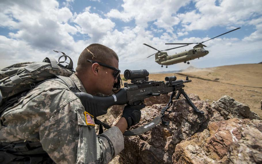A U.S. Army Reserve combat engineer from the 374th Engineer Company covers a sector of fire during an air assault landing July 18, 2015, during a two-week field training exercise known as a Sapper Leader Course Prerequisite Training at Camp San Luis Obispo Military Installation, Calif.