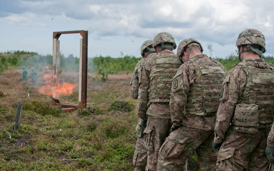 Soldiers with 503rd Infantry Regiment, 173rd Airborne Brigade Combat Team, stack up near a simulated door during a demolition range July 19, 2015, at the Central Training Area, near Tapa, Estonia, during Operation Atlantic Resolve. Throughout the day, soldiers practiced building and setting the various charges they had learned about the previous day.