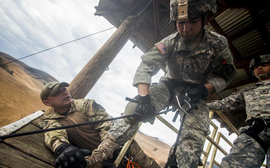 A U.S. Army Reserve combat engineer from the 374th Engineer Company checks his rope before rappelling a 100-foot tower, July 19, 2015, during a two-week field exercise known as a Sapper Leader Course Prerequisite Training at Camp San Luis Obispo Military Installation, Calif.