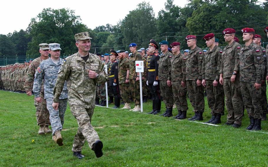 Ukrainian and U.S. officers review troops in formation during a ceremony marking the start of Rapid Trident 2015, a long-standing cooperative training exercise focused on stability and peacekeeping operations, in Yavoriv, Ukraine, July 20, 2015. More than 1,800 personnel from 18 different nations are participating in the exercise.