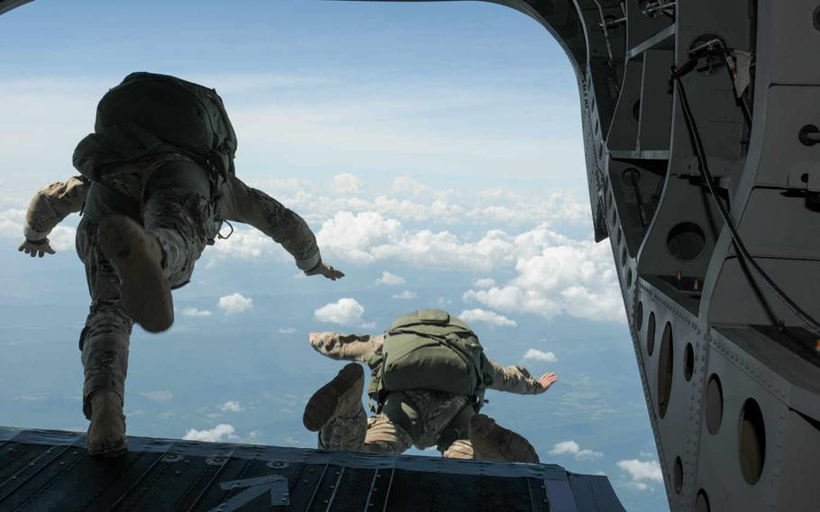 Maryland Army National Guard Soldiers freefall from 13,000 feet during a jump with C Company, 1st Squadron, 158th Cavalry Regiment, on July 18, 2015, over Little Orleans, Md. The LRS unit, based out of Hagerstown, is scheduled to be disbanded in August.