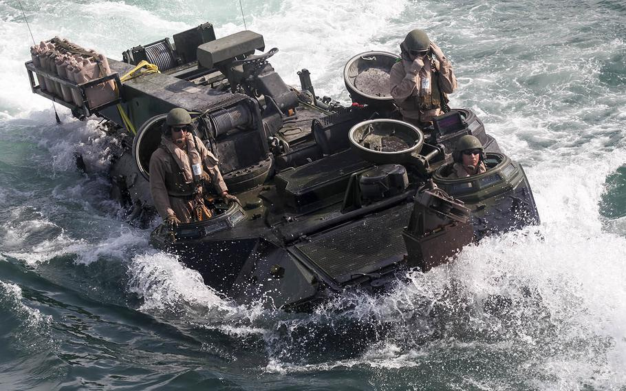 Marines with Amphibious Assault Platoon, Company E, Battalion Landing Team 2/6, load the unit's amphibious assault vehicles aboard the USS Oak Hill (LSD-51) during the 26th Marine Expeditionary Unit's Composite Training Exercise, July 19, 2015.