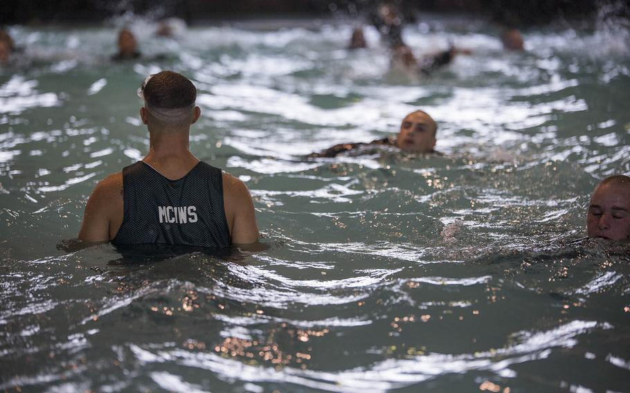 Recruits of Company B, 1st Recruit Training Battalion, swim 25 meters during basic water survival training July 20, 2015, on Parris Island, S.C.