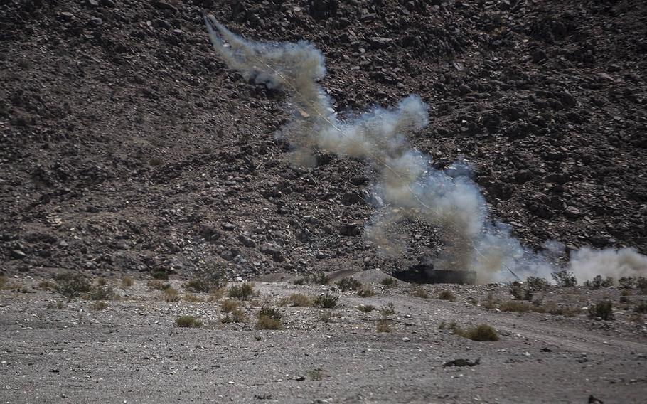 An Amphibious Assault Vehicle attached to 1st Battalion, 3rd Marine Regiment, launches an M58 Mine Clearing Line Charge during a live-fire training exercise aboard Marine Corps Air Ground Combat Center Twentynine Palms, Calif., July 21, 2015.
