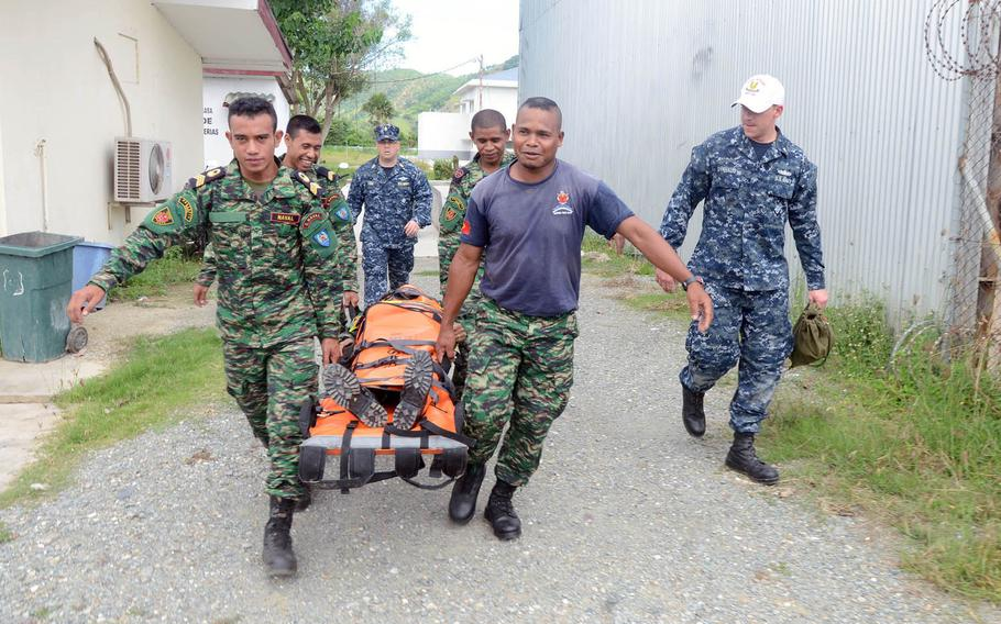 Sailors assigned to the guided-missile destroyer USS Kidd and members of East Timor's Defense Force conduct stretcher bearer training during a medical skills exchange during last year's Cooperation Afloat Readiness and Training (CARAT). CARAT is a series of annual bilateral exercises conducted with Bangladesh, Brunei, Cambodia, Indonesia, Malaysia, Philippines, Singapore, Thailand, and Timor Leste.
