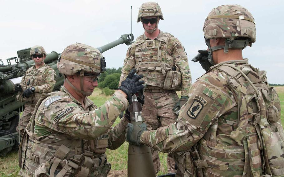 The fins, or canards, on the M1156 Precision Guidance Kit fuse are part of the guidance system that the Army says greatly increases accuracy of rounds. Here, soldiers from the 173rd Airborne Brigade Combat Team practice loading the shell before live fires at Vilseck, Germany, July 23, 2015.