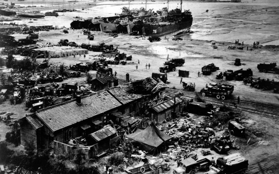 Land Ship Tanks unload at Wolmi-do, Inchon, Korea on D-plus and Marine trucks to take supplies to advancing troops. In 2011, a group of approximately 160 former residents of Wolmi Island filed suit against the government, seeking compensation for property lost during a September 1950 bombing of the island.