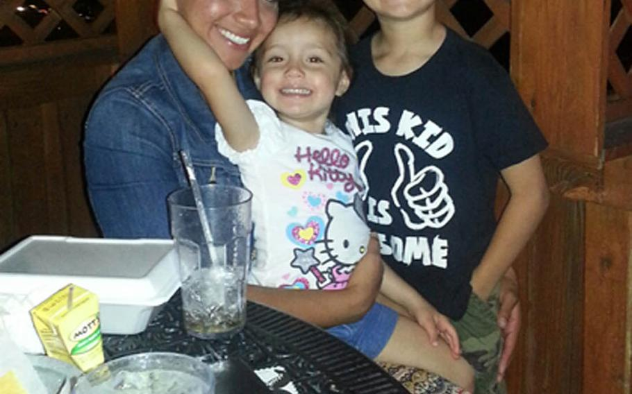 Marine Sgt. Jennifer Suarez, posing with her children, beat brain cancer and returned to active duty in the Marine Corps.