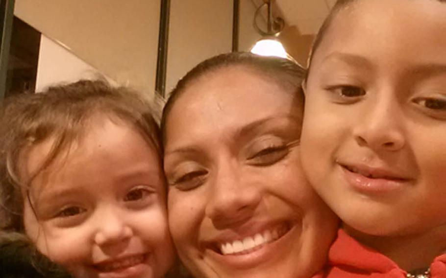 Marine Sgt. Jennifer Suarez, seen here with her 2 children, beat brain cancer and returned to active duty in the Marine Corps.