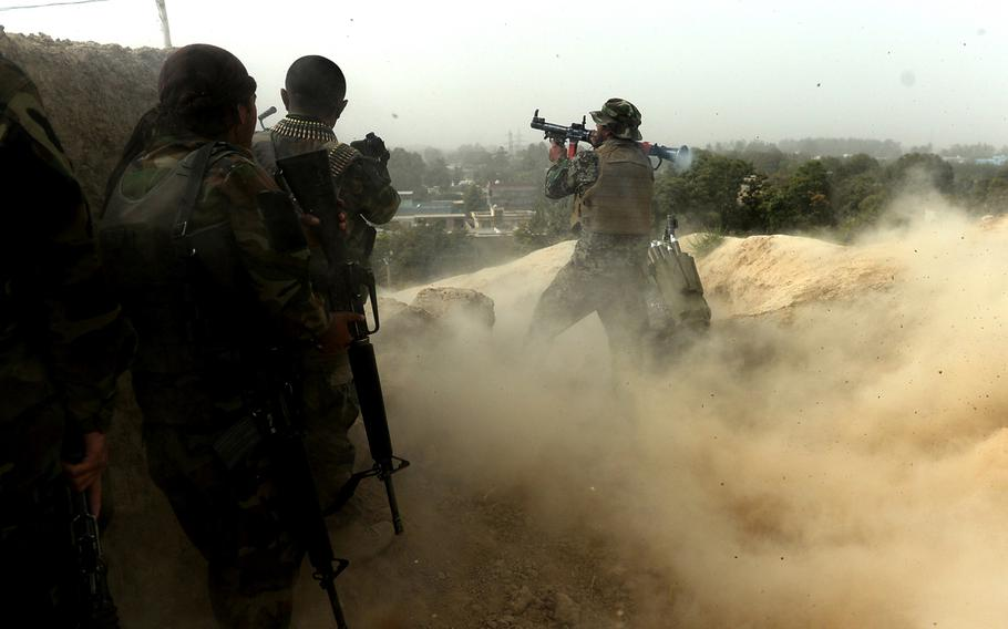 An Afghan soldier fires a rocket-propelled grenade at Taliban positions on the outskirts of Kunduz during mop-up operations in October 2015. It took nearly two weeks of house-to-house fighting before most pockets of Taliban resistance had been eliminated.
