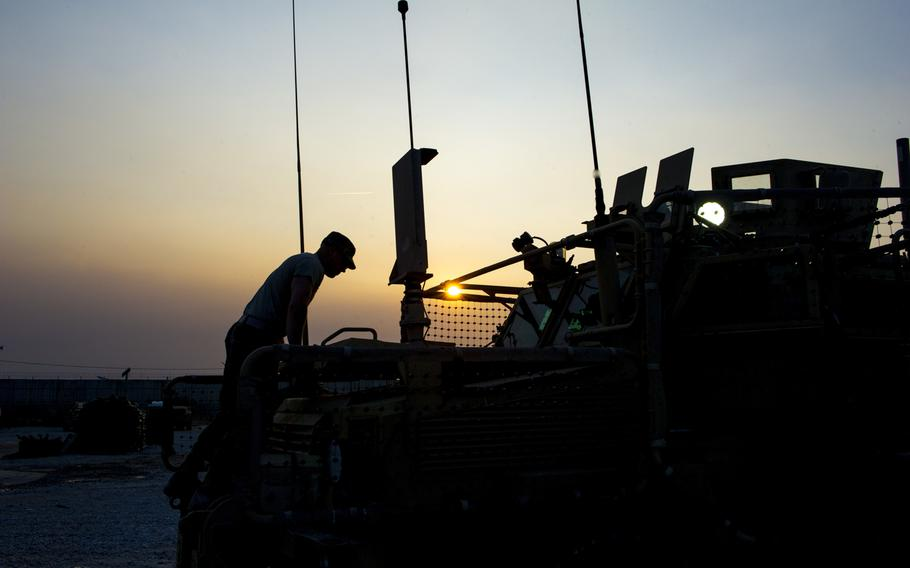 Spc. Samuel L. Esposito, with the 317th Brigade Engineer Battalion, 3rd Brigade Combat Team, 10th Mountain Division (Light Infantry), closes the hood on a Mine Resistant Ambush Protected vehicle at Bagram Air Field, Afghanistan, Jan. 12, 2016.