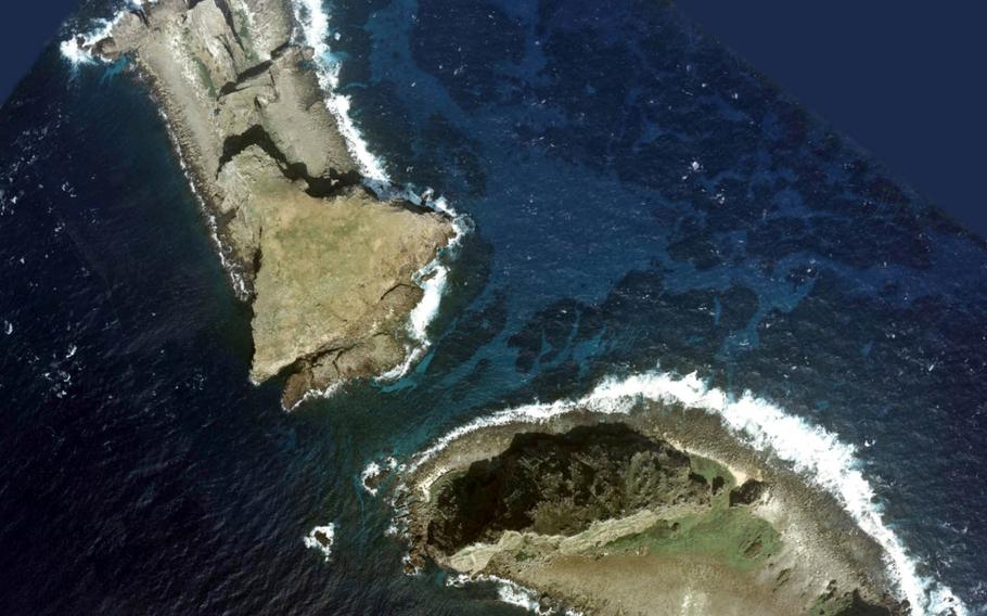 An aerial photo of two Senkaku islands, Kitakojima, top, and Minamikojima.