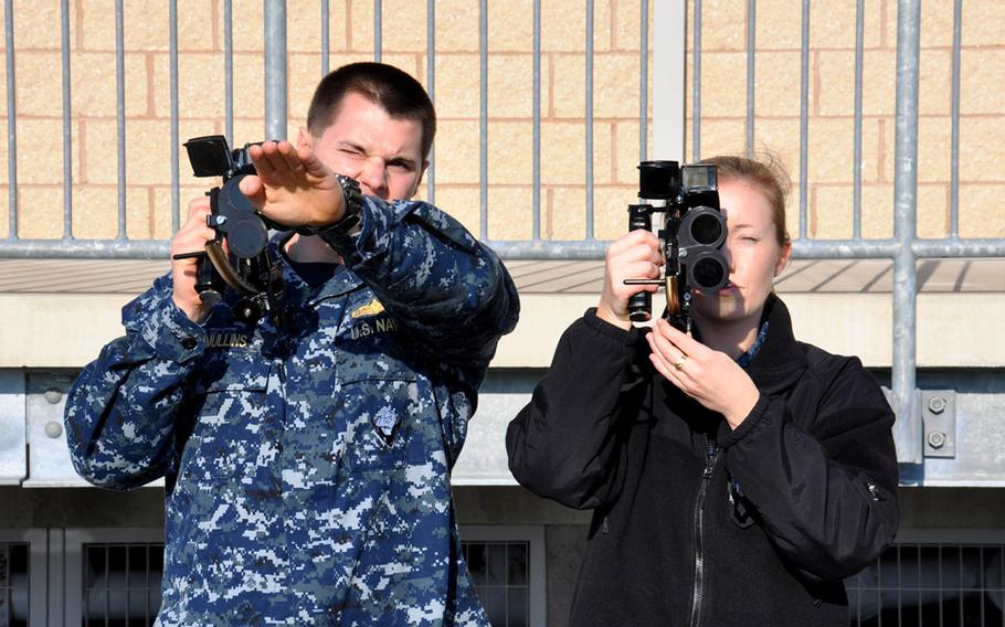 Lt. Kevin Mullins, Surface Warfare Officer School surface navigator course leader, instructs Lt. Corey Schulz on proper sextant procedures, Dec. 10, 2015, in Newport, R.I. The sextant is used to take the altitude of the sun at Local Apparent Noon to determine latitude in celestial navigation.
