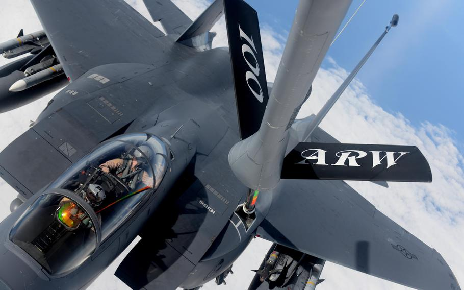 A KC-135 Stratotanker from the 100th Air Refueling Wing refuels an F-15E Strike Eagle from the 48th Fighter Wing, Thursday, Nov. 12, 2015, over the northern Mediterranean. The U.S and allies are now examining plans to strike hard against Islamic State militants in Libya, who have gained a foothold in the country in the years since the U.S.-led NATO alliance helped topple  Moammar Gadhafi.