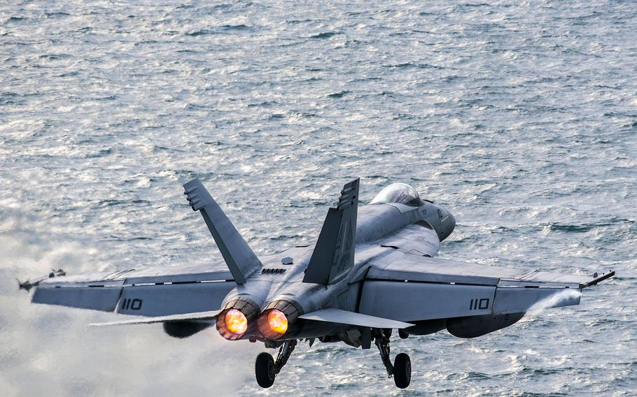 """An F/A-18E Super Hornet, assigned to the """"Pukin' Dogs"""" of Strike Fighter Squadron 143, launches from the flight deck of aircraft carrier USS Harry S. Truman in the Persian Gulf, Wednesday, Dec. 30, 2015. The U.S and allies are now examining plans to strike hard against Islamic State militants in Libya, who have gained a foothold in the country in the years since the U.S.-led NATO alliance helped topple  Moammar Gadhafi."""
