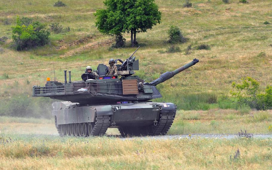 A U.S. Army M1A2 Abrams tank, manned by soldiers of the 3rd Combined Arms Battalion, 69th Armor Regiment, rumbles across Novo Selo Training Area, Bulgaria, following a live-fire exercise that closed the Kabile 2015 tactical exercise on Thursday June 25, 2015. A congressionally mandated panel has recommended that the Army return an armored brigade to Europe along with a war fighting aviation headquarters to counter a more aggressive Russia on the continent.