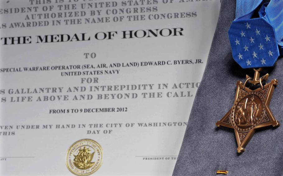 The Medal of Honor citation for Navy SEAL Senior Chief Petty Officer Edward C. Byers Jr., is seen on Feb. 18, 2016.