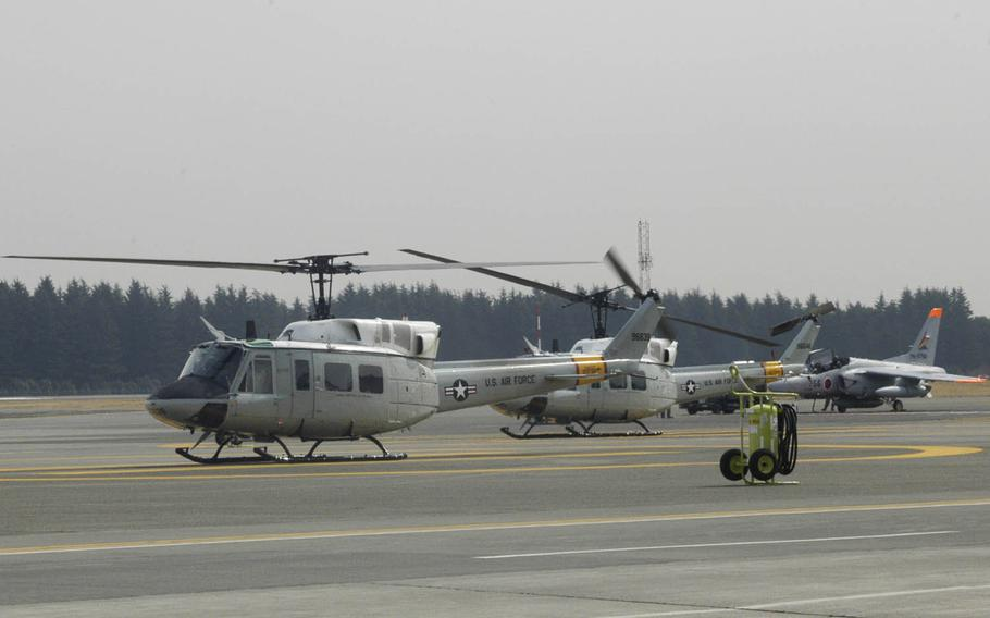 UH-1 Iroquois helicopters are seen at Yokota Air Base, Japan, Monday, Feb. 29, 2016. A UH-1 assigned to Yokota with nine people onboard made an emergency landing at a Japanese civilian airport that morning. Yokota officials did not provide information about what forced the aircraft down.