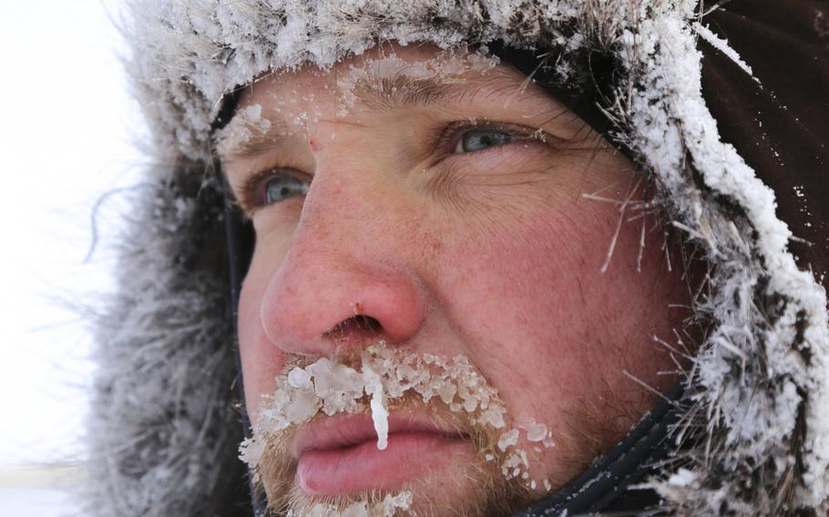 Chief Petty Officer Aaron Cook, a machinist's mate,  braves the cold while supervising a work party at U.S. Navy Ice Camp Nautilus, located on a sheet of ice adrift on the Arctic Ocean, as part of Ice Exercise (ICEX) 2014. ICEX 2016 began March 2. The U.S. Navy exercise highlights submarine capabilities in an arctic environment.