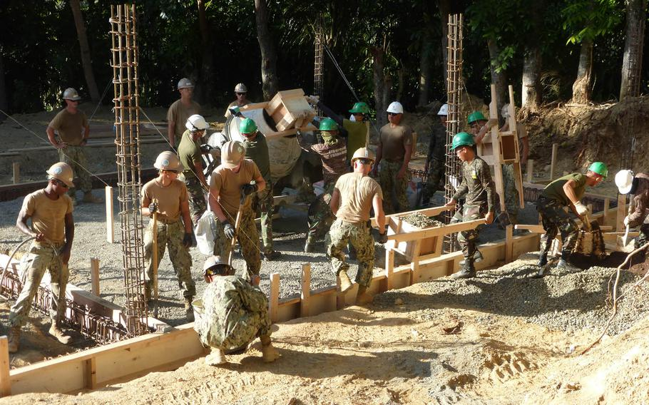 Seabees assigned to Naval Mobile Construction Battalion 3 build a school in Cebu, Philippines, in January. The fighting construction force is getting a new logo for its 75th anniversary next year.