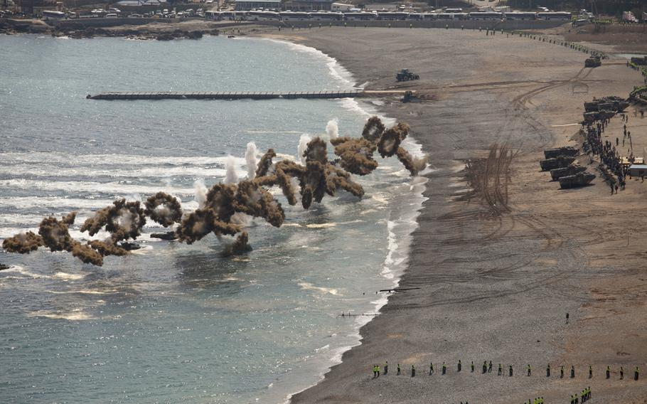 Korean Assault Amphibious Vehicles with Republic of Korea Marine Corps Regimental Landing Team 7 take part in a beach landing March 12, 2016, during exercise SsangYong 16.