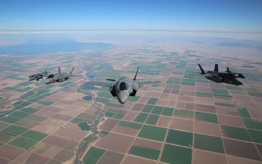 Three F-35B Lightning II Joint Strike Fighters with Marine Fighter Attack Squadron 121, 3rd Marine Aircraft Wing, and two AV-8B Harriers with Marine Attack Squadron 211, 3rd MAW, fly in formation over eastern California in 2013. Assistant Secretary of the Navy Sean Stackley announced plans to deploy F-35 stealth fighters to Marine Corps Air Station Iwakuni next January at a congressional hearing on Wednesday, March 23, 2016.