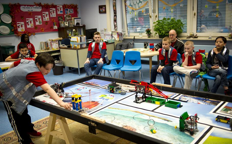 Mordecai Kenemore, left, a fifth-grade student at Kaiserslautern Elementary School, makes adjustments to Lego obstacles during a DODEA-Europe robotics competition for 10- to 14-year-old students in Kaiserslautern, Germany, on Monday, March 28, 2016. Thirty-two students from four schools participated in the competition via video.