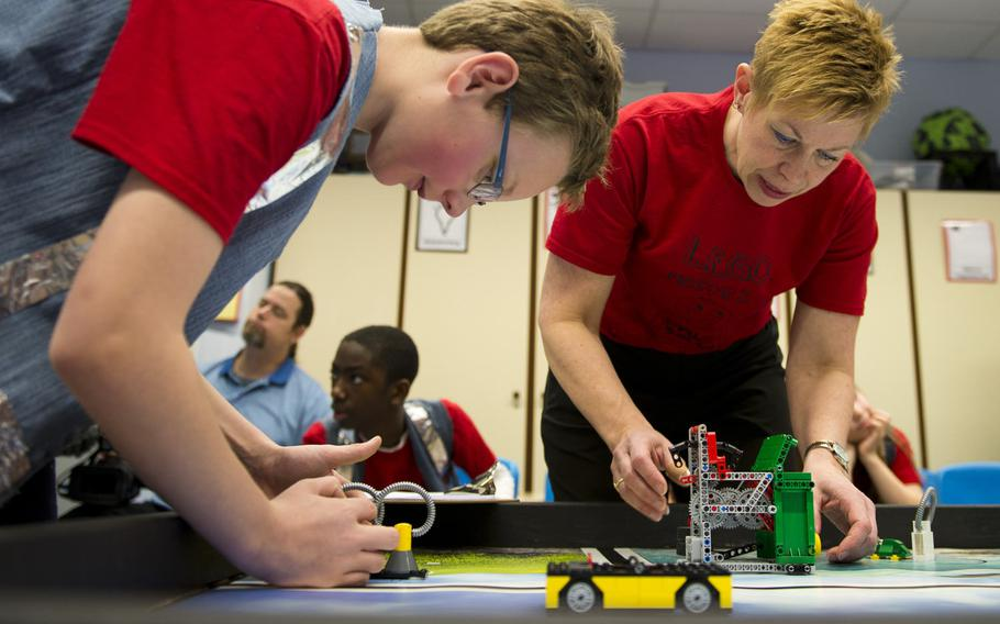 Elizabeth Quinn, right, a gifted resource educator, and Albert Vandeway, a fourth-grade student at Kaiserslautern Elementary School, make adjustments to Lego obstacles during a DODEA-Europe robotics competition for 10- to 14-year-old students in Kaiserslautern, Germany, on Monday, March 28, 2016. Teams from Kaiserslautern Elementary, Bitburg Elementary, Vogelweh Elementary and Spangdahlem Middle School linked up virtually for the district-wide competition.