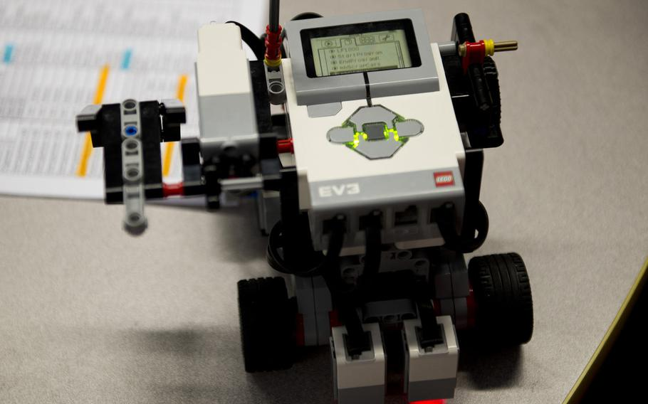 A team's Lego Mindstorms EV3 robot is prepared for its turn during a DODEA-Europe robotics competition for 10- to 14-year-old students in Kaiserslautern, Germany, on Monday, March 28, 2016. The robots used during the competition were programmed to complete several tasks, and the teams were scored on how well the robot performed.