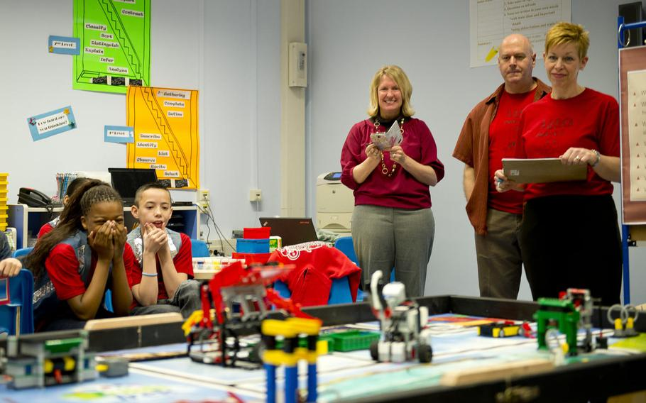 Kaiserslautern Elementary School students and faculty watch a robot maneuver through the course during a DODEA-Europe robotics competition for 10- to 14-year-old students in Kaiserslautern, Germany, on Monday, March 28, 2016. Teams from Kaiserslautern Elementary, Bitburg Elementary, Vogelweh Elementary and Spangdahlem Middle School linked up virtually for the district-wide competition.