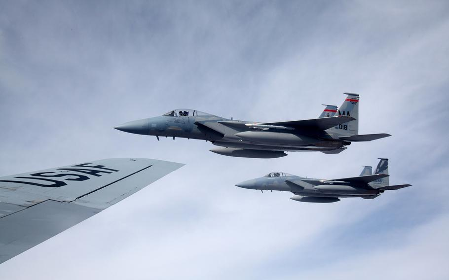 Air National Guard F-15C Eagles assigned to the 131st Fighter Squadron, Barnes Air National Guard Base, Mass. and the 194th Fighter Squadron, Fresno Air National Guard Base, Calif., fly beside a KC-135 Stratotanker Feb. 11, 2016, after refueling.Twelve F-15C Eagles and approximately 350 airmen and support equipment from the two squadrons will deploy to the European theater beginning April 1, 2016.