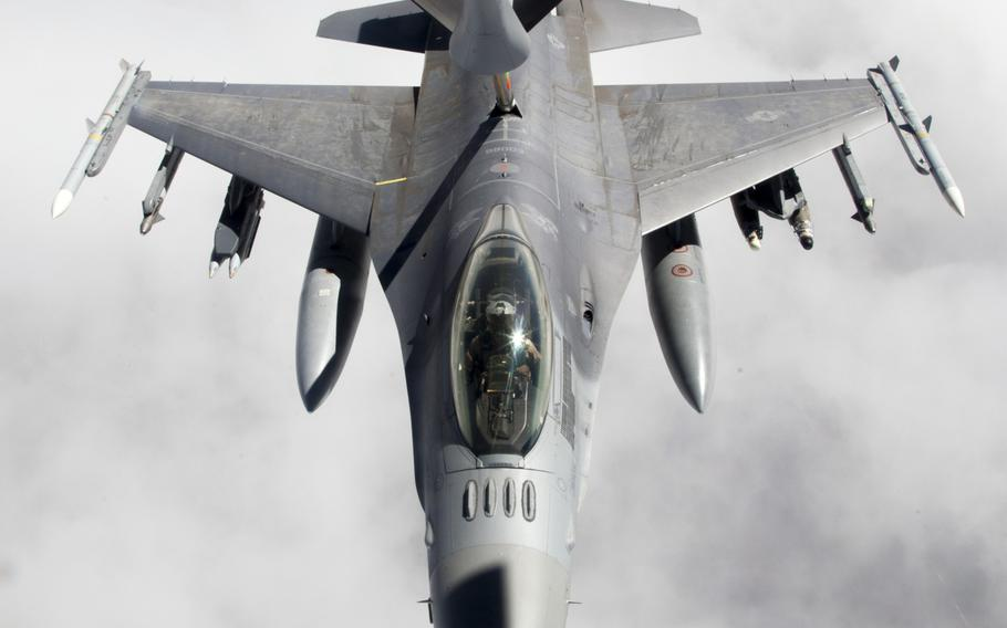 An F-16 fighter supporting air operations against the Islamic State group in Iraq and Syria undergoes a midair refueling from a KC-135 Stratotanker on March 24, 2016.