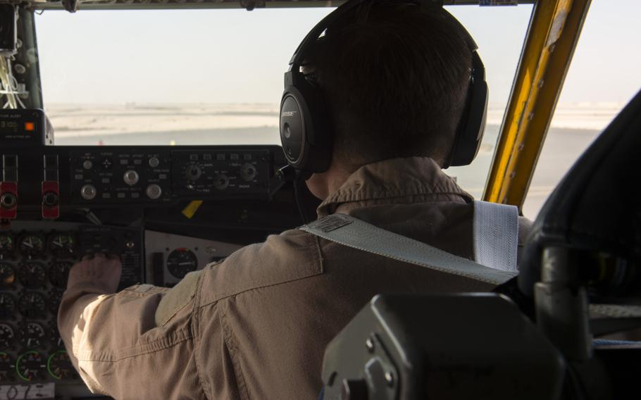 KC-135 Stratotanker co-pilot 1st Lt. Scott checks equipment prior to taking off from Al Udeid Air Base in Qatar for a refueling mission in support of the air campaign against the Islamic State group in Iraq and Syria on March 24, 2016. Crewmembers could not be identified by their full names for security reasons.