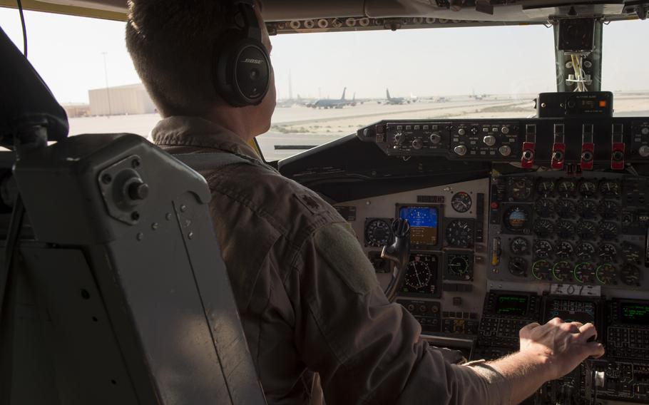 KC-135 Stratotanker aircraft commander and pilot Maj. Joe drives the aircraft during taxiing prior to taking off from Al Udeid Air Base in Qatar for a refueling mission in support of the air campaign against the Islamic State group in Iraq and Syria on March 24, 2016.  Crewmembers could not be identified by their full names for security reasons.