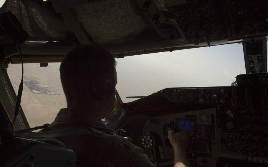 KC-135 Stratotanker aircraft commander and pilot Maj. Joe flies the aircraft shortly after takeoff from Al Udeid Air Base in Qatar for a refueling mission in support of the air campaign against the Islamic State group in Iraq and Syria on March 24, 2016. Crewmembers could not be identified by their full names for security reasons.