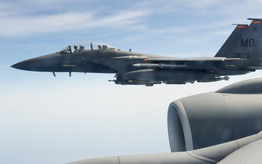 An F-15 fighter flies alongside a KC-135 Stratotanker while supporting air operations against the Islamic State group in Iraq and Syria on March 24, 2016.