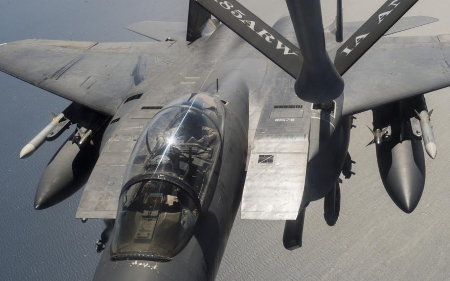 An F-15 fighter supporting air operations against the Islamic State group in Iraq and Syria refuels from a KC-135 Stratotanker over the Persian Gulf on March 24, 2016.