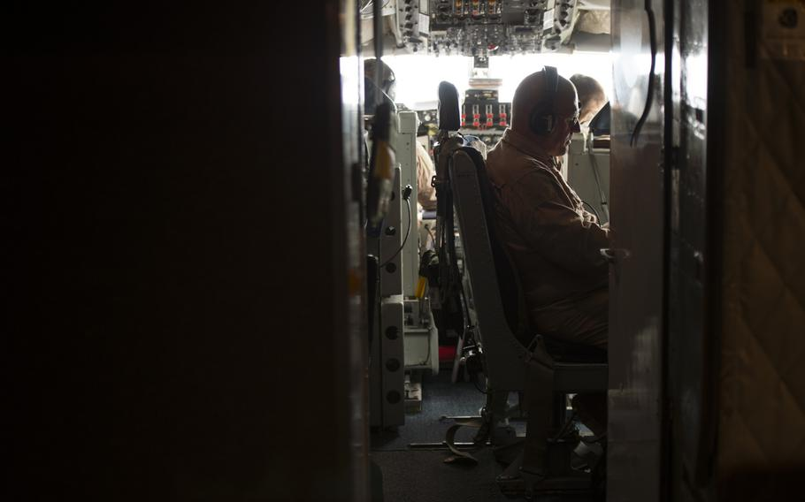 KC-135 Stratotanker Boom Operator Chief Master Sgt. Tim sits in the cockpit between aircraft refuelings on March 24, 2016. Crewmembers could not be identified by their full names for security reasons.