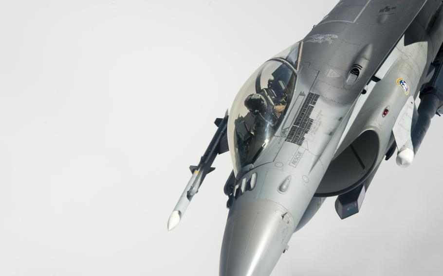 An F-16 fighter supporting the air campaign against the Islamic State group in Iraq and Syria maneuvers away from a KC-135 Stratotanker after an aerial refueling on March 24, 2016.