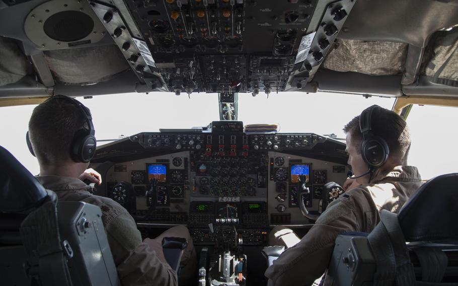 KC-135 Stratotanker aircraft commander and pilot Maj. Joe, left, and co-pilot 1st Lt. Scott fly the aircraft and maintain radio communications throughout their refueling mission on March 24, 2016, in support of the air campaign against the Islamic State in Iraq and Syria. Crewmembers could not be identified by their full names for security reasons.