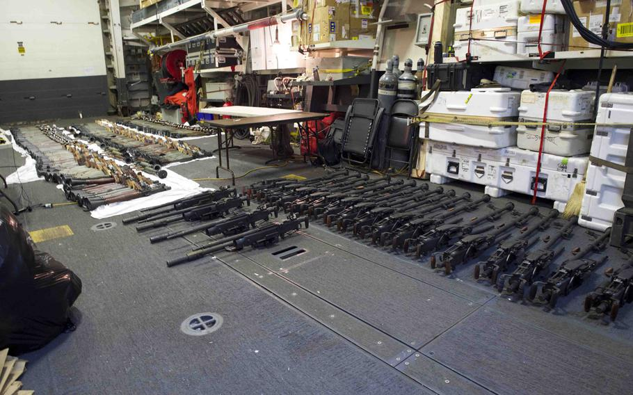 A cache of weapons is assembled on the deck of the guided-missile destroyer USS Gravely on March 31, 2016. The weapons were seized three days earlier from a stateless dhow, which was intercepted by the coastal patrol ship USS Sirocco. The cargo included 1,500 AK-47s, 200 rocket-propelled grenade launchers and 21 .50-caliber machine guns.