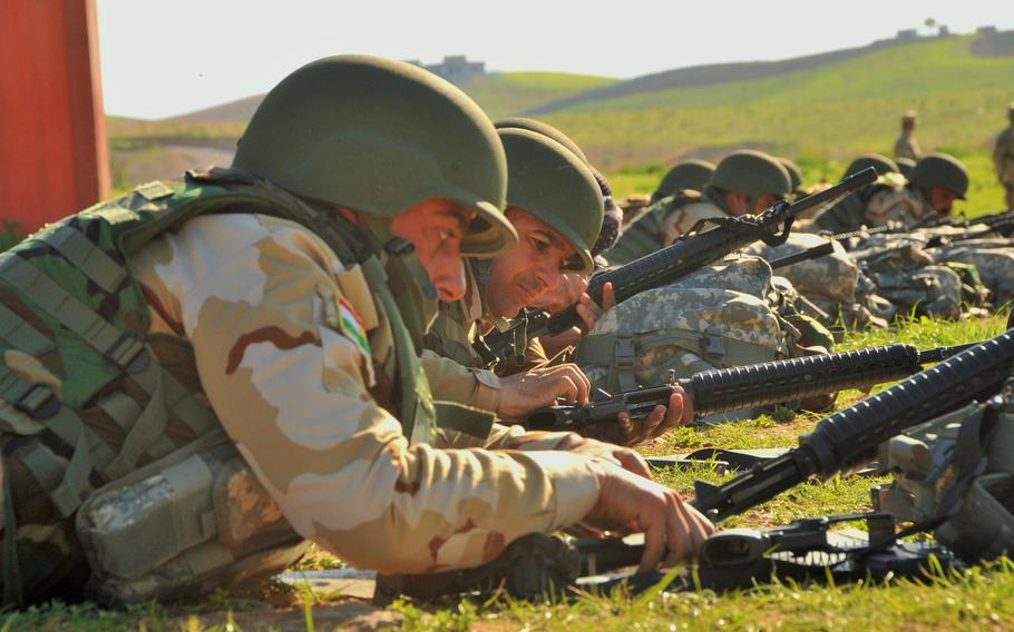 Members of the Peshmerga Modern Brigade Course are given instruction on Basic Rifle Marksmanship by members of the international coalition against the Islamic State group in the vicinity of Irbil, in northern Iraq, in March 2016.  The Basic Rifle Marksmanship course provides instructions on target identification, sighting and zeroing in of weapons, qualification and weapons maintenance.