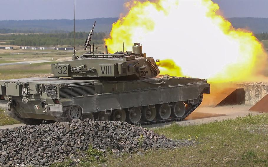 An Italian C1 Ariete battle tank fires at a target during a maneuver drill on Wednesday, May 11, 2016, as part of the 2016 Strong Europe Tank Challenge held at the Grafenwoehr, Germany training area over the course of a week.