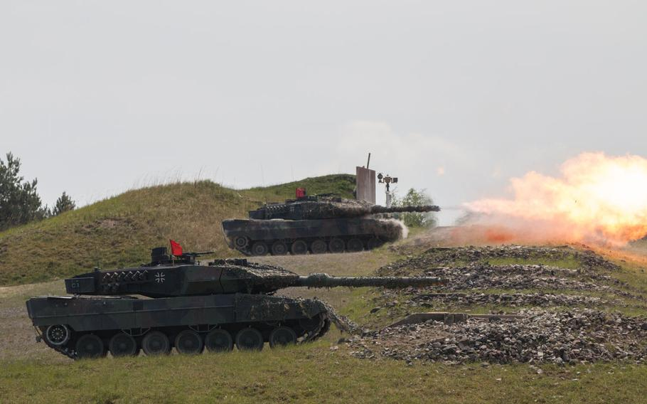 German Leopard 2A6 battle tanks fire downrange during a maneuvers at the 2016 Strong Europe Tank Challenge held at the Grafenwoehr, Germany training area on Wednesday, May 11, 2016.