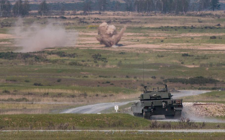 An Italian C1 Ariete battle tank fires at a target on Wednesday, May 11, 2016, as part of the 2016 Strong Europe Tank Challenge held at the Grafenwoehr, Germany training area.