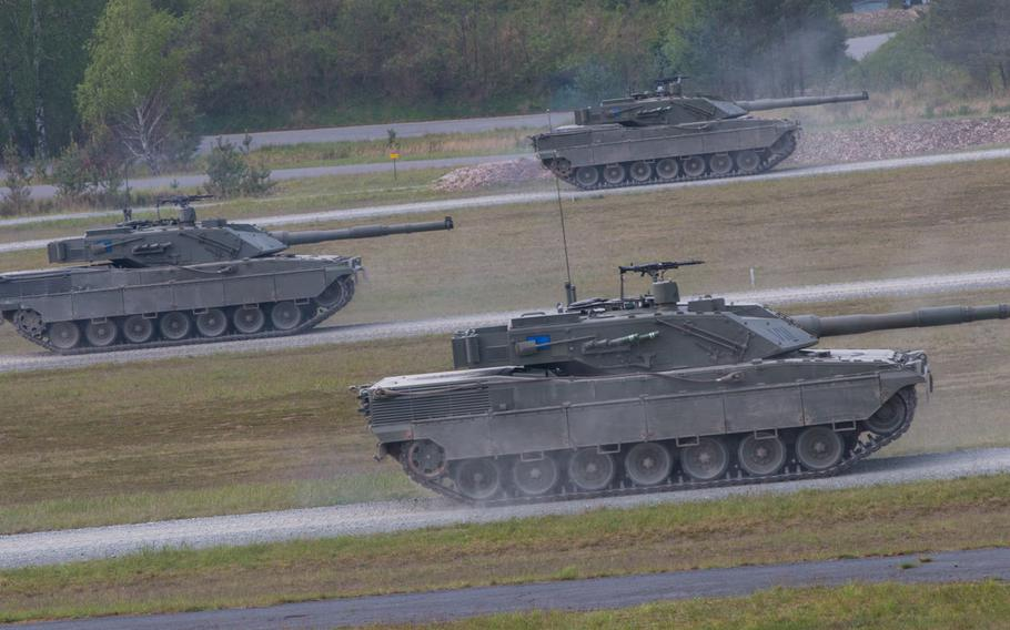Italian C1 Ariete battle tanks roll out on Wednesday, May 11, 2016, as they took part in the 2016 Strong Europe Tank Challenge held at the Grafenwoehr, Germany training area.